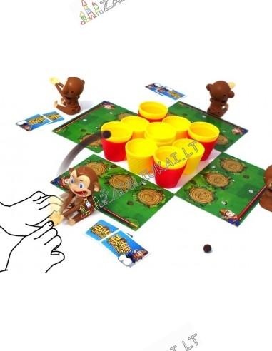 Stalo žaidimas su beždžionėlėm