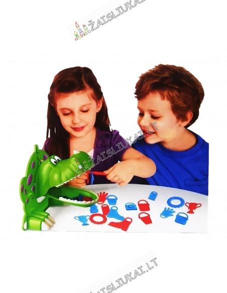 Stalo žaidimas su Dinozauru